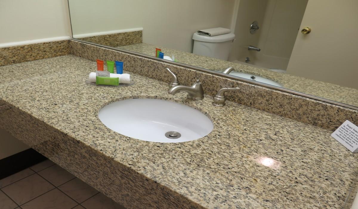 Bonanza Inn Guestrooms - Vanity in Private Bathroom at Bonanza Inn